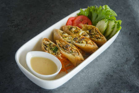 chinese spring roll and souce on loft