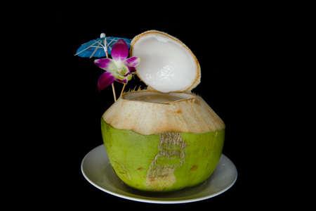 coconut juice on black background.