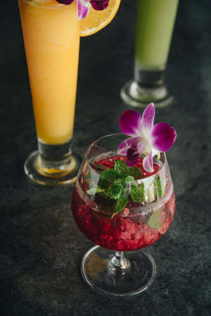 red cocktail and colorful cocktail  and juice