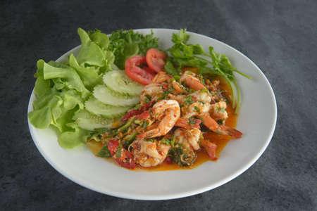 Spicy garlic chilli Prawns Shrimps on dark background