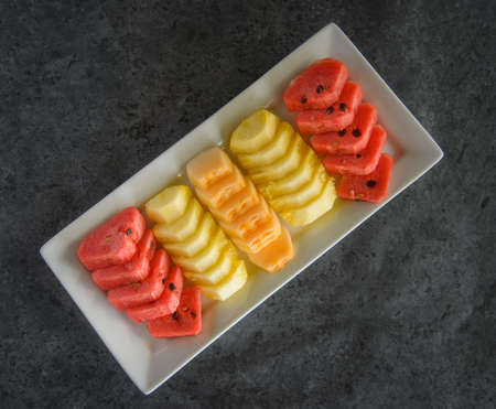 sliced fruit on dish, pineapple and watermalon and melon. 免版税图像