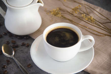 Coffee cup and coffee beans on table and tea 免版税图像
