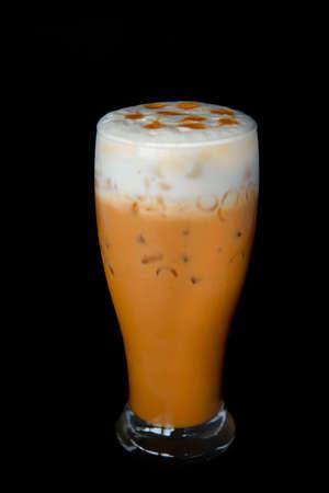 chayen or thai tea on black background.