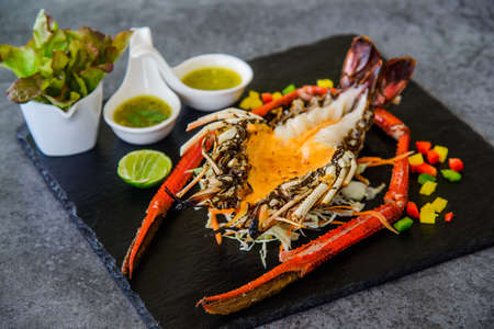 Grilled Lobster and seafood souce on plate. 免版税图像