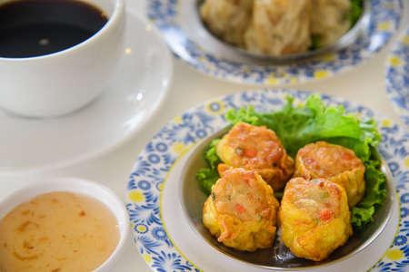 fried Dumpling traditional chinese food with souce and coffee as breakfast