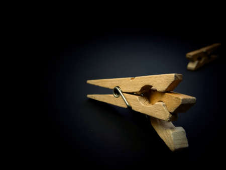 Fighting of wooden clothespins on dark background. Illustration aggression issues. Part of photoset.