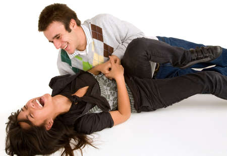 clowning: Young Girl being Tickled by Young Man   Stock Photo