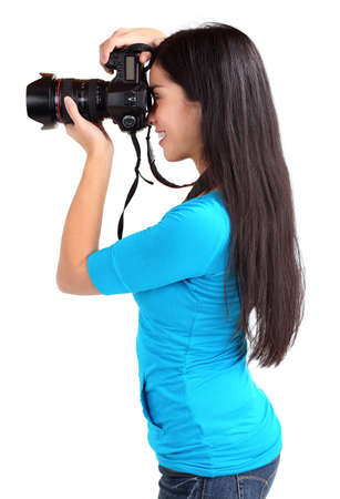 slr cameras: Female Photographer Shooting Someone or Something Stock Photo