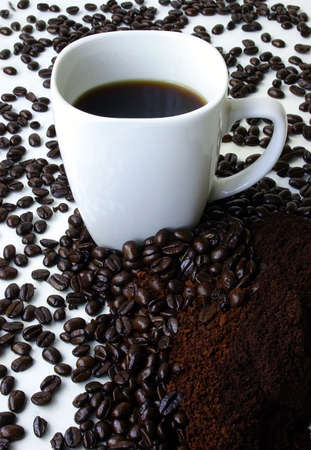 A Mug of Coffee Surrounded by Coffee Beans