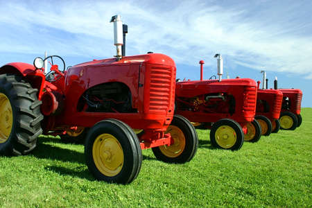 old tractors: Several Old Tractors Stock Photo