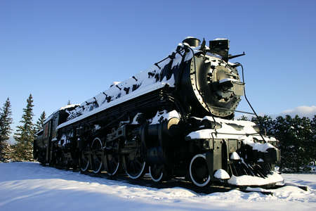 the heavyweight: Old Steam Locomotive Covered With Snow Stock Photo