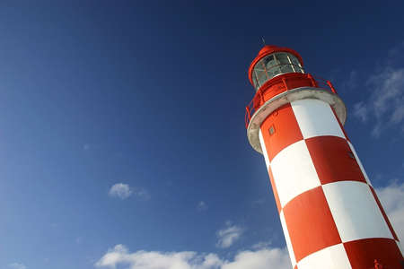 forewarning: Lighthouse Under a Deep Blue Sky.