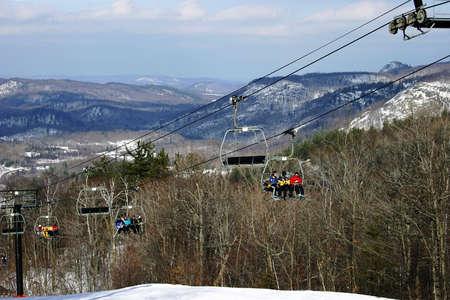 mountainous: Ski Chair-Lift with Mountainous Background