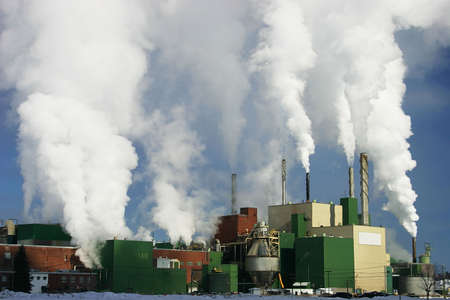 steam output: Paper Mill Producing a Lot of Smoke 2 Stock Photo