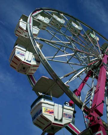 exhilaration: Ferris Wheel at a Fair Stock Photo