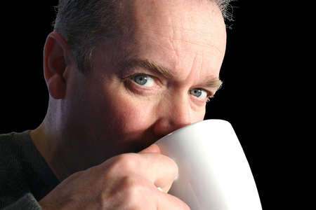 sip: Man drinking coffee