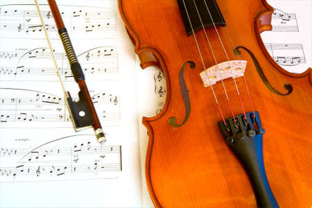 Violin and a Bow on a Music Sheet