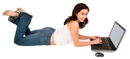 Young Smiling Woman on Floor Using Laptop Stock Photo - 2330965