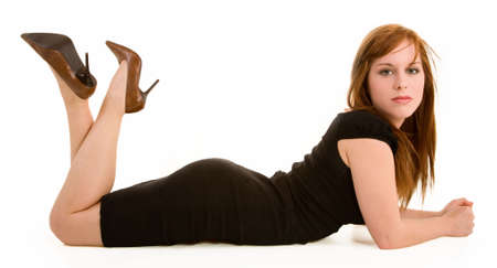 Beautiful Redhead Lying Down and Looking at the Camera