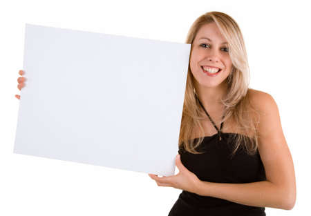 Beautiful young woman holding a blank white sign Standard-Bild
