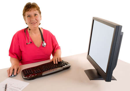 Smiling Beautiful Middle Aged Nurse or Doctor  Sitting at her Desk