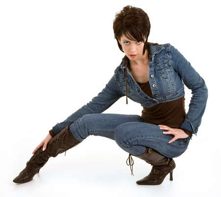 Attractive Brunette Lady Posing Creatively Wearing Jeans and Leather Boots Imagens