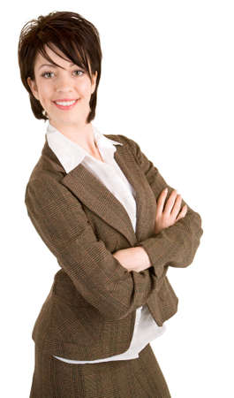 Attractive Smiling Businesswoman Standing With her Arms Crossed. photo