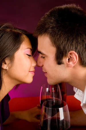 Couple Getting Closer While Having Wine photo