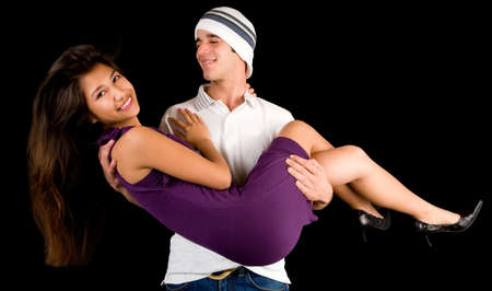 Young Man Holding Girl in his Arms Stock Photo - 3976967