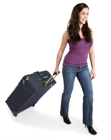 Smiling Young Lady Pulling her Luggage