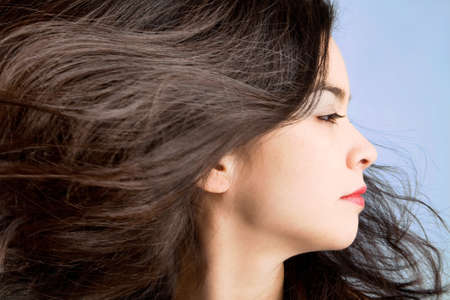 wind blown hair: Hair in a Swirling Wind Stock Photo