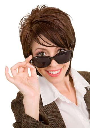 fair skin: Beautiful Brunette Looking Over Sunglasses Stock Photo