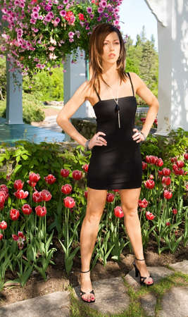 Sexy Lady Standing in Front of Tulips  photo