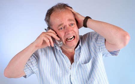 電話の受信側の悪いニュース 写真素材