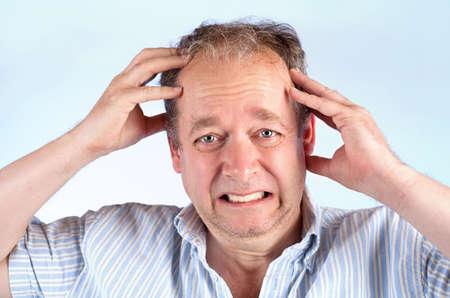 splitting headache: Man Suffering from a Migraine or Bad News.