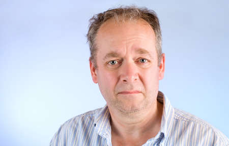 sad eyes: Middle-Aged Man Unhappy About Something Stock Photo