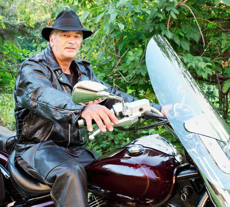 Middle-Aged Man Riding Motorcycle photo