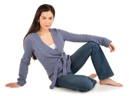 Beautiful Casually Dressed Woman Sitting on the Floor photo