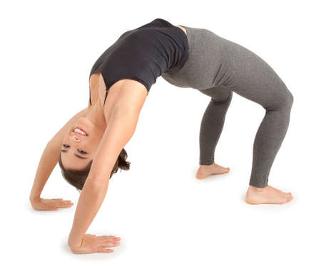 Young Woman doing the Bridge Pose Imagens