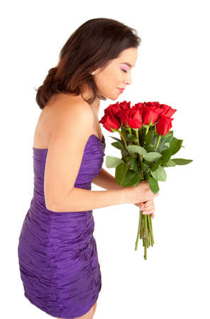 Woman Holding and Smelling Roses photo