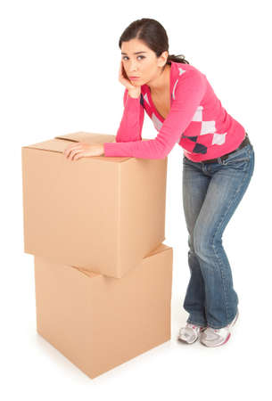 struggling: Tired Woman Leaning on Boxes