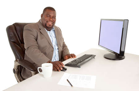 Smiling African American Businessman Sitting at His Desk Stok Fotoğraf