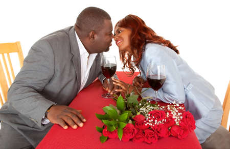 African American Couple About to Kiss in Romantic Dinner photo