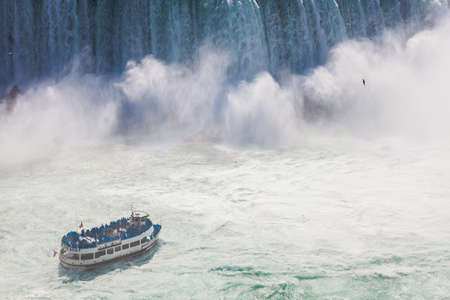 Niagara-Falls, Ontario, Canada - July 5, 2015: View of a tour boat, Maid of the Mist, navigating near the horseshoe falls in Niagara Falls, Ontario, Canada. Editorial