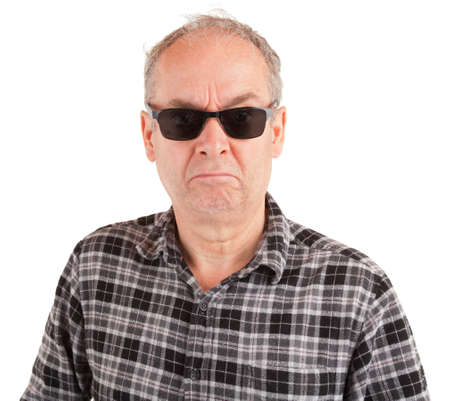 A disgruntled guy is wearing sunglasses Stock Photo