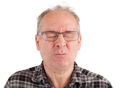 De mens heeft iets zuurs gegeten Stockfoto