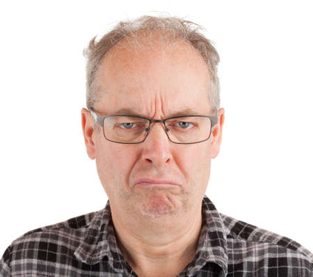 This is a portrait of a grumpy middle aged man.
