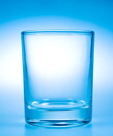 Empty glass with blue toning photo
