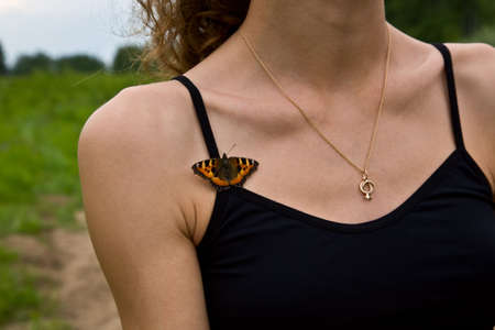 Butterfly on woman breast