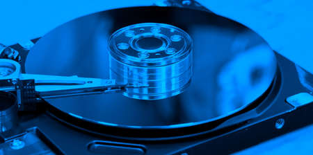 Open hard drive with blue toning. Stock Photo